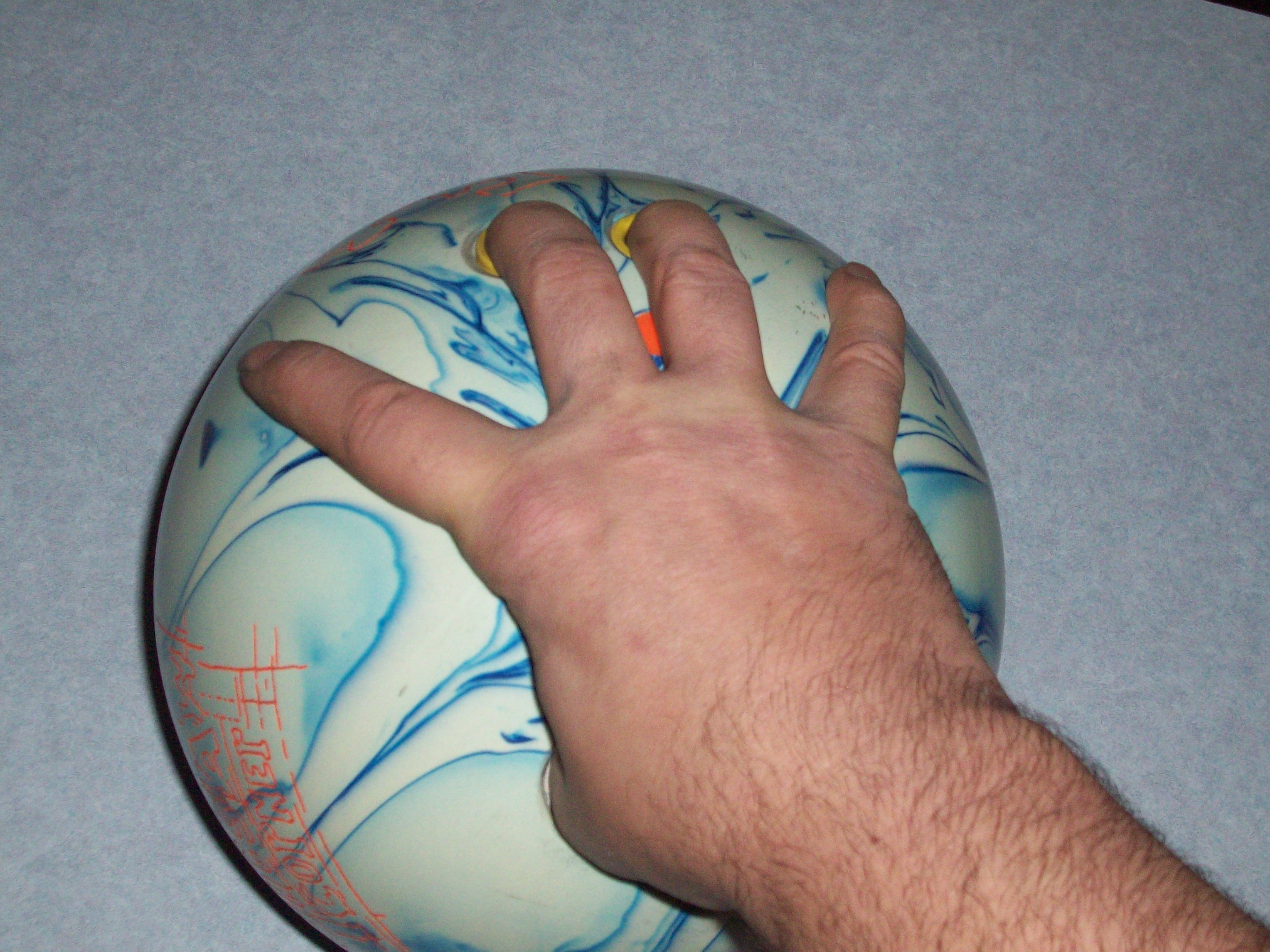 Bowling Finger Positions, Wide Index and Pinkie Finger Position, Bowling Wrist Hand Positions,  Hand Position Used In Bowling, Wide Index and Pinkie Finger Position in Bowling, bowling, ball, hand, finger, wrist, positions
