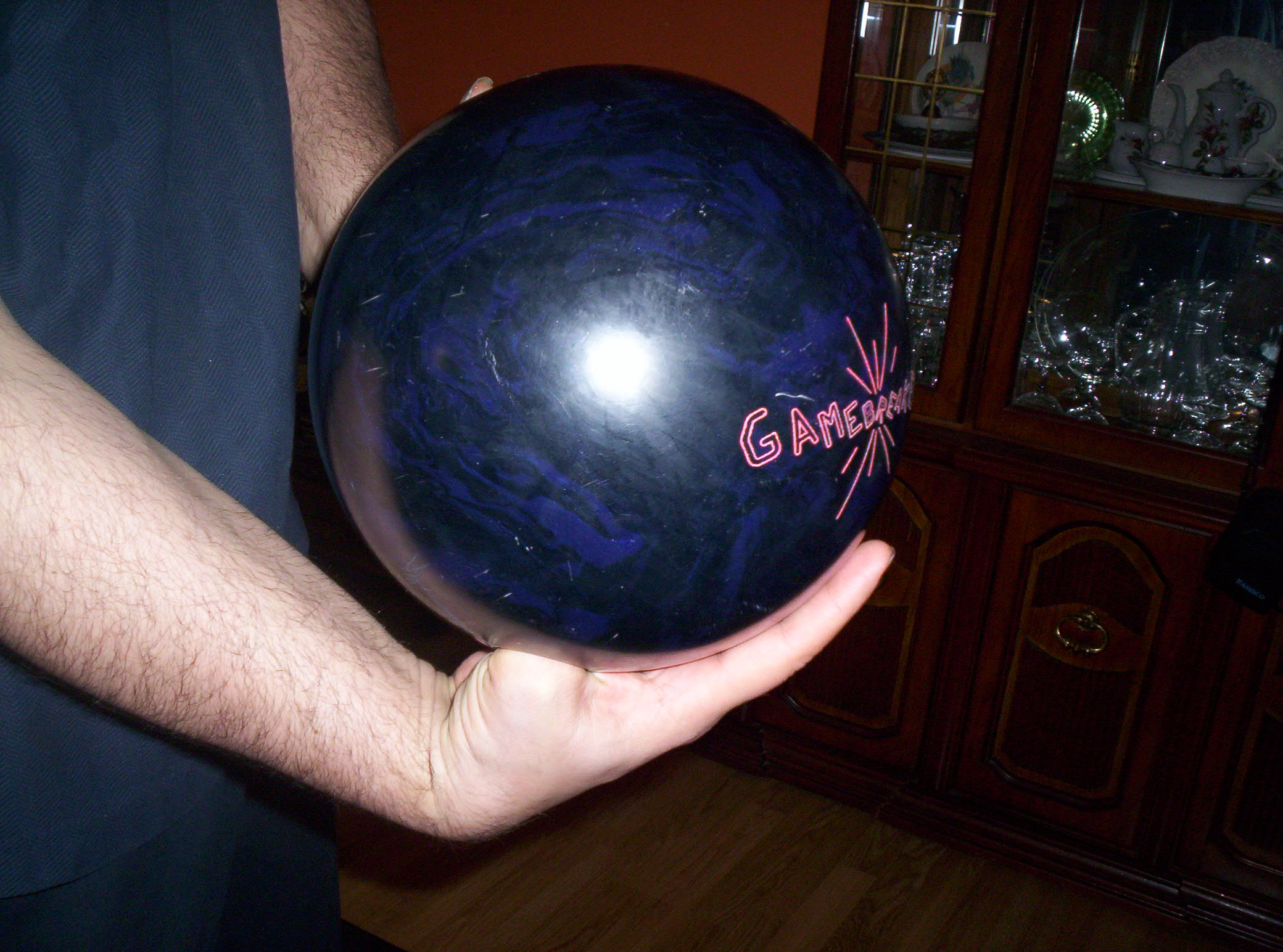 cupped, bowling wrist position